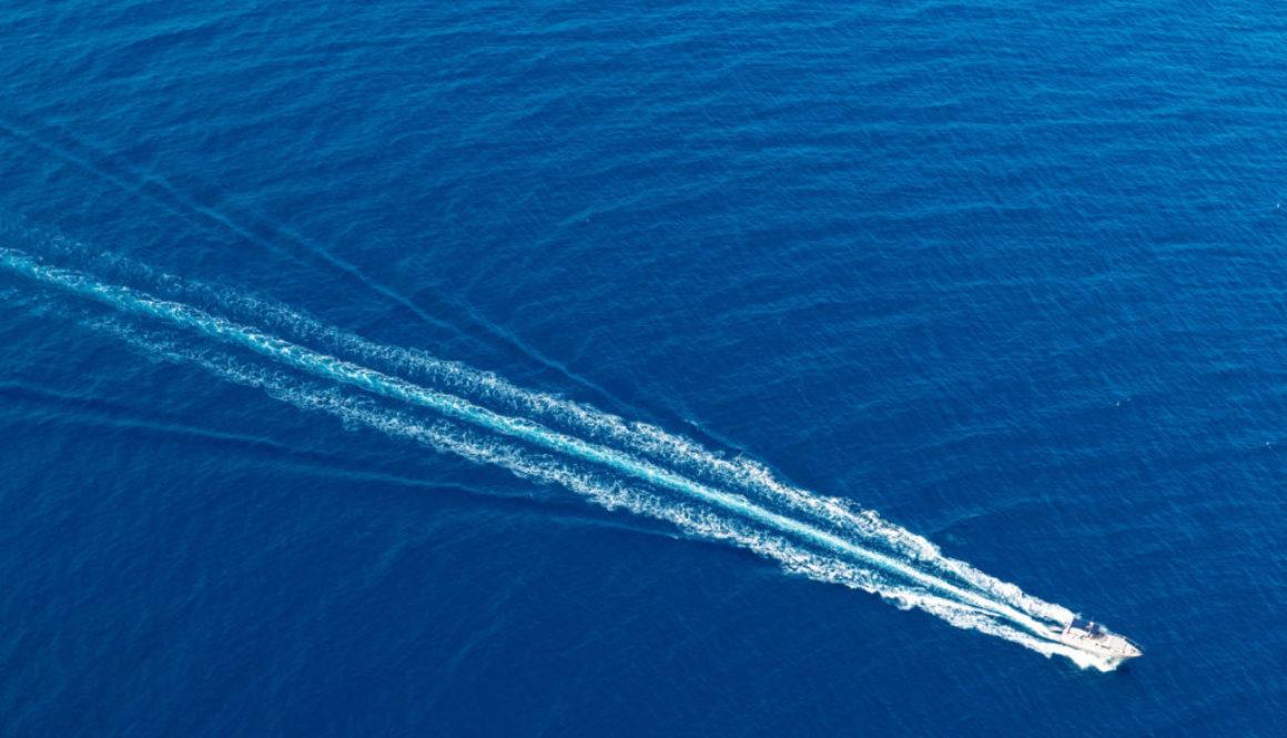 bigstock-boat-surf-foam-aerial-from-pro-85257980