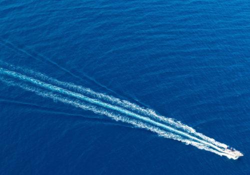 bigstock-Boat-surf-foam-aerial-from-pro-85257980-1024x683-1024x585
